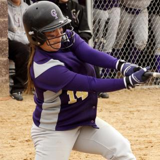 Softball player swinging bat