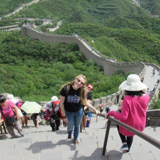Young woman climbs the Great Wall in China