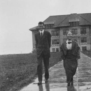 1900s photo of two people outside Sterry Hall