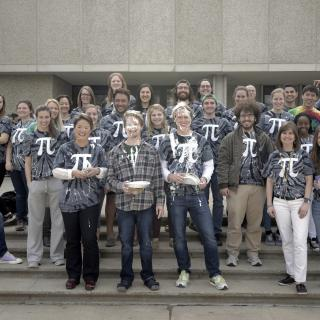 Math students and faculty pose for a Pi Day photo