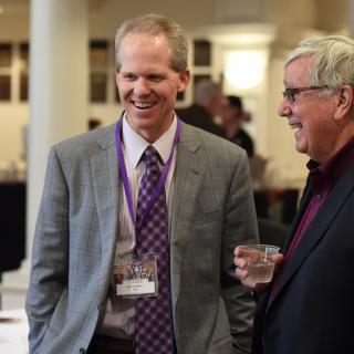 Bob Hoover and Jack Cafferty laughing at an event