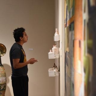 Student looking at artwork in Rosenthal Gallery
