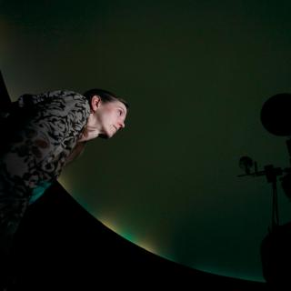 Person in the Planetarium