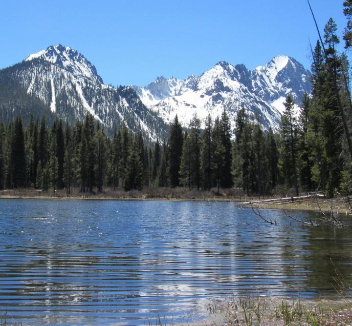 Lake with mountains in the background