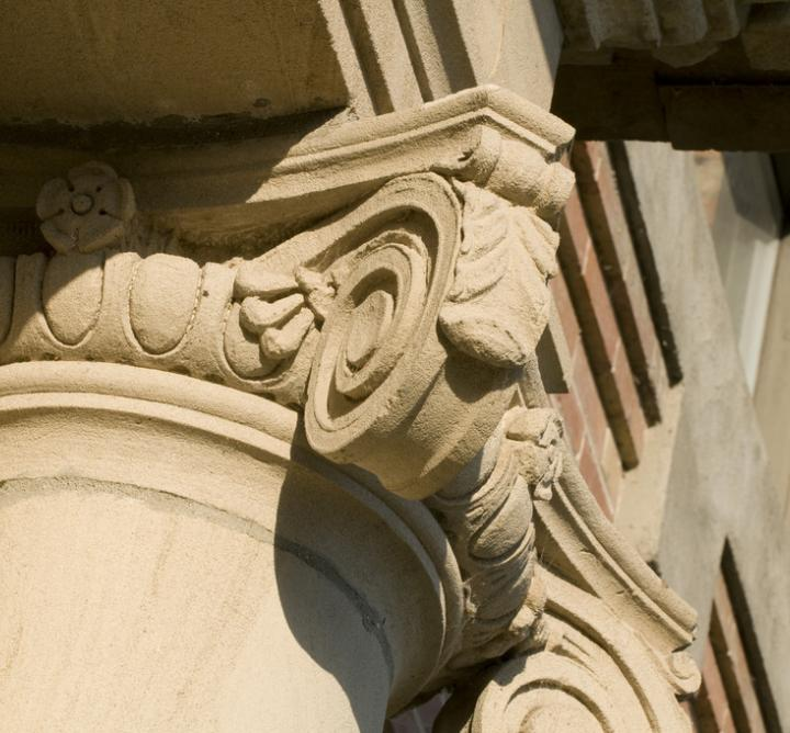 Scroll atop a building column
