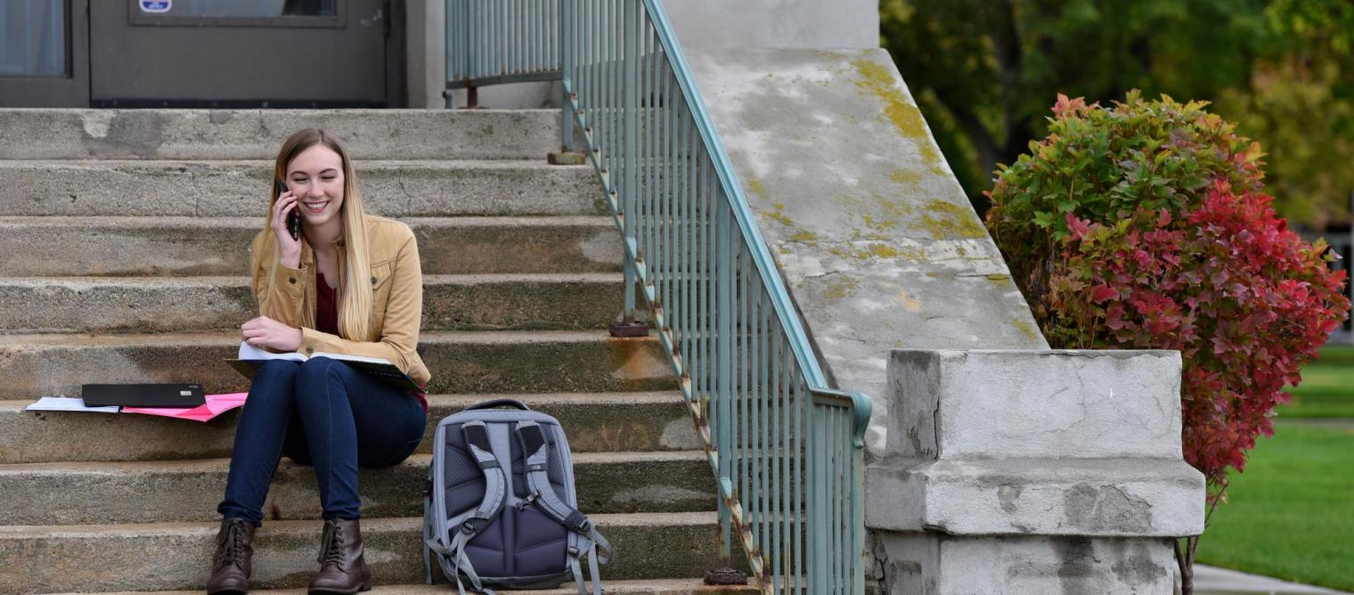 Student on building steps