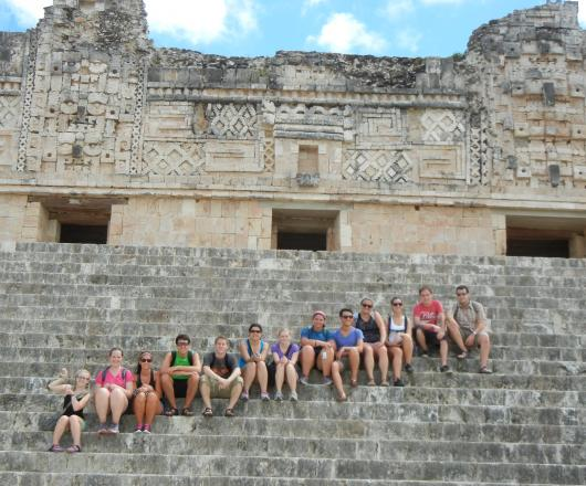 Students on the steps of ancient ruins