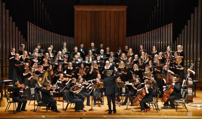 C of I Chorale and Sinfonia perform on stage in Jewett Auditorium