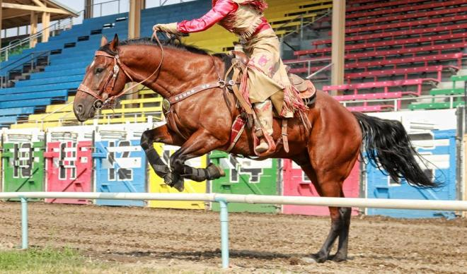 C of I senior Betsy West takes a jump on horseback during the 2017 Pendleton Round-Up