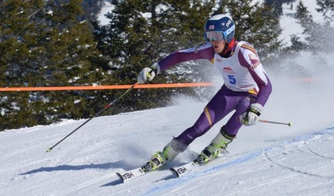 Lucas Underkoffler skis down a mountain as part of the C of I men's skiing team.