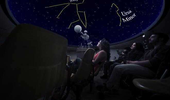 Visitors at the Whittenberger Planetarium learn more about the night sky.