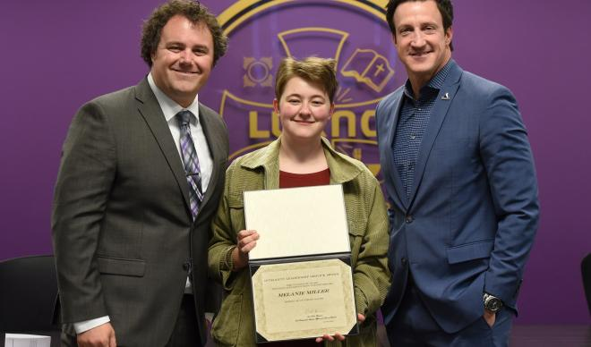 Melanie Miller (center) stands with Matt Gier (left) and Paul Bennion (right) after receiving the Student Affairs Integrity, Leadership and Service Award.
