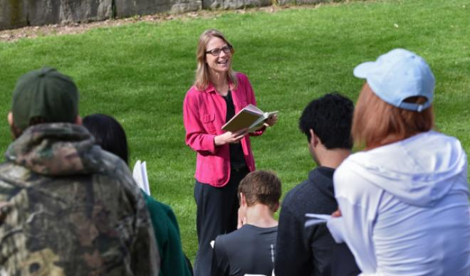 Dr. Rochelle Johnson teaches students outside on the College of Idaho campus.