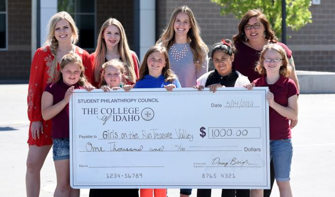 Representatives of the Student Philanthropy Council present a check for $1,000 to Girls on the Run Treasure Valley.