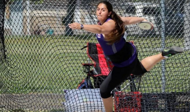 Claire Otero prepares a discus throw during track-and-field competition.