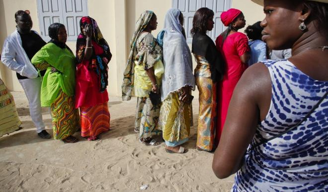 Senegalese women queuing to vote at a polling station in Dakar.