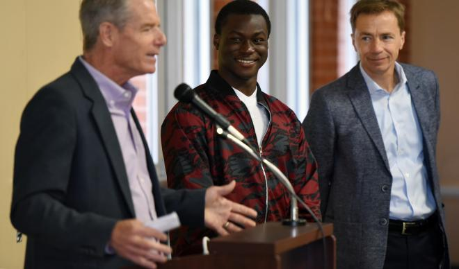 Jim Everett (left) delivers a speech at the 6th Annual Caldwell Youth Forum alongside C of I freshman Omotayo Akingba and C of I Co-President Doug Brigham.