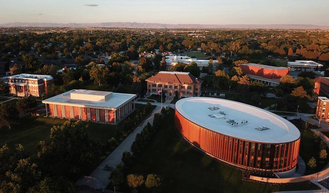 An aerial shot of The College of Idaho at sunrise.