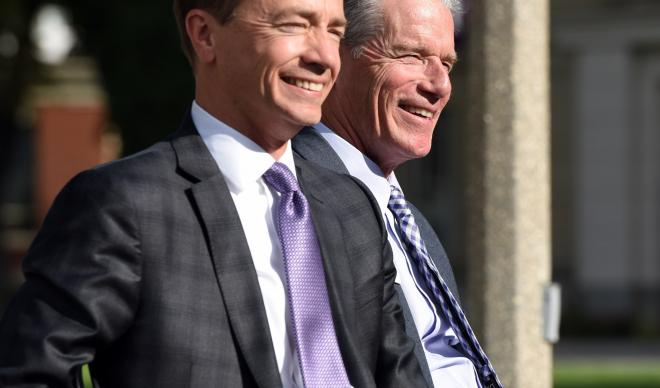 Doug Brigham (left) and Jim Everett (right) laugh together at their official inauguration ceremony as co-presidents.