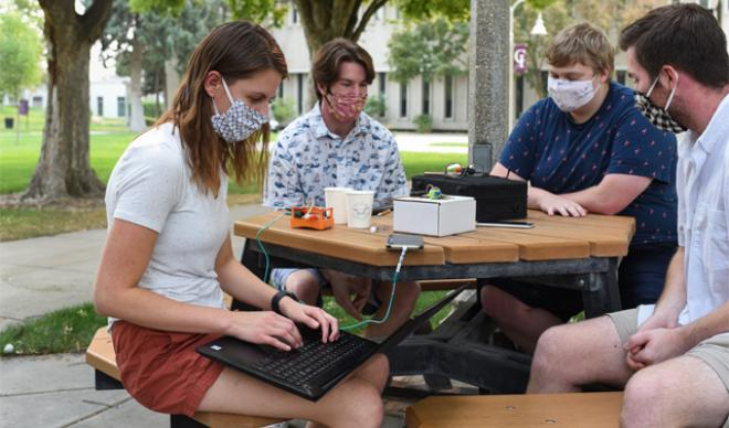 Masked students working in Quad
