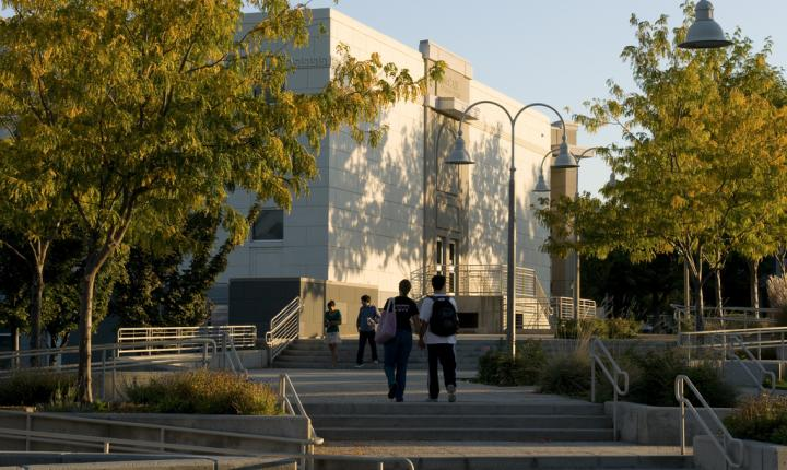Students walk by a campus building