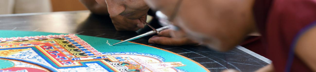 Tibetan monks create a sand mandala